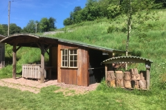 Campers Bothy with covered, lockable bike storage area plus log seats